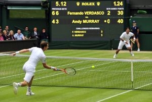 Andy Murray and Fernando Verdasco in tennis whites on the recognizable grass courts of Wimbledon.